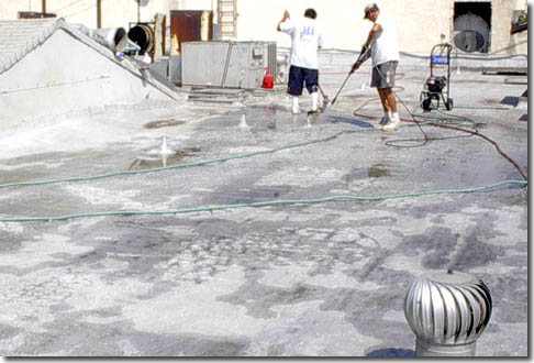 Elastomeric Roof Coating Application On Built Up Roof